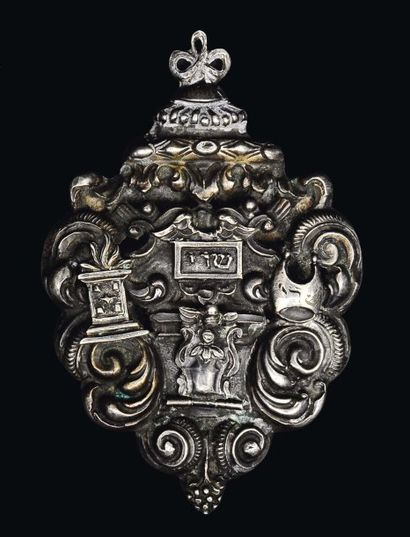 Amulette en argent qui devait servir à protéger...