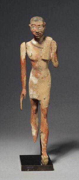 Statuette de modèle. Elle représente un homme...