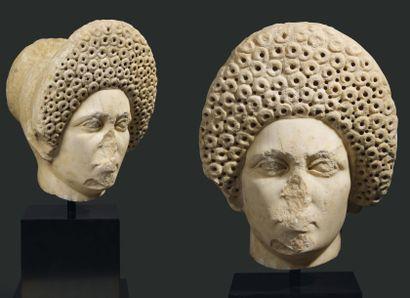 Portrait de patricienne. Il représente une femme de face, le visage ovale présentant...