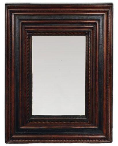 Très important miroir à encadrements en poirier...
