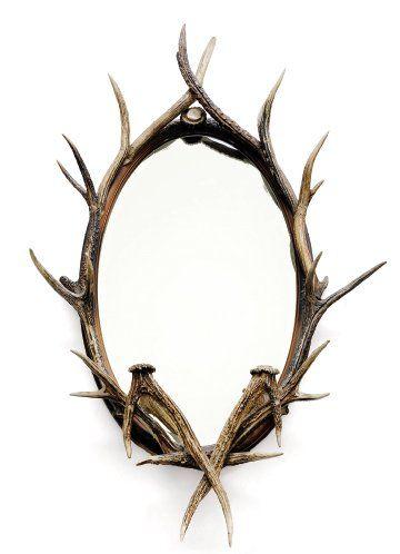 Miroir ovale à décor de bois de cerfs. Ovale...