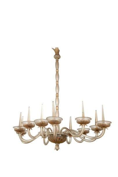 TRAVAIL ITALIEN Grand lustre ovale à douze bras de lumière Verre de Venise argenté...