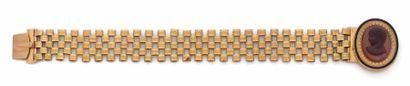 BRACELET en or 18K (750) articulé de petits...