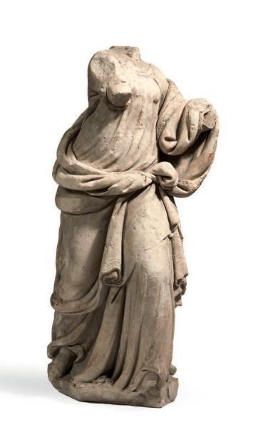 STATUE ACÉPHALE en pierre calcaire sculptée...