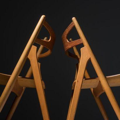 HANS J. WEGNER (1914-2007) Danemark Exceptionnelle suite de douze chaises modèle...