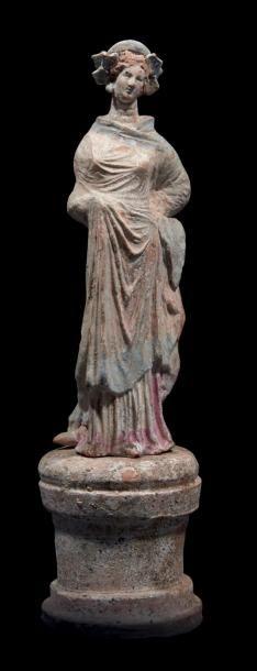 STATUETTE DE CANOSA. Statuette de type tanagréen...
