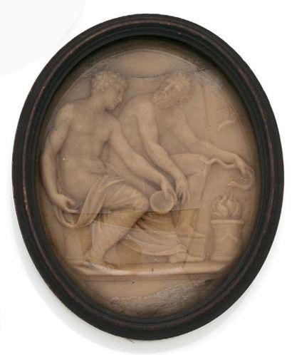 MÉDAILLON ovale en cire figurant deux personnages...