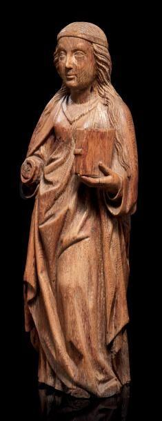 Sainte Lucie en chêne sculpté en ronde-bosse....