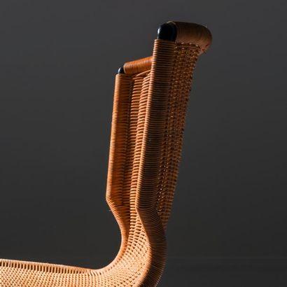 LOUIS SOGNOT (1892-1970) France Suite de quatre chaises Fer forgé laqué noir et rotin...