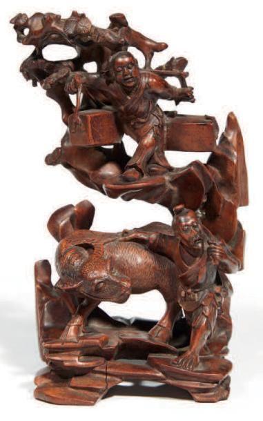 GROUPE en bois sculpté à décor de paysan,...