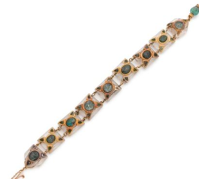 Bracelet articulé de 9 motifs en verre incolore...