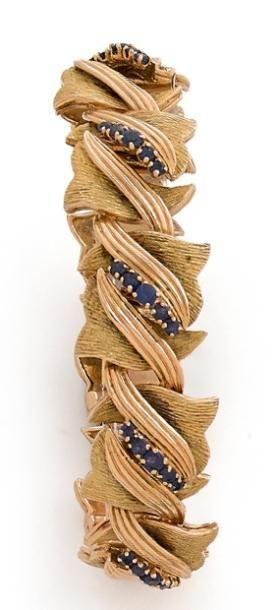 Bracelet en or 18K (750), articulé de motifs...