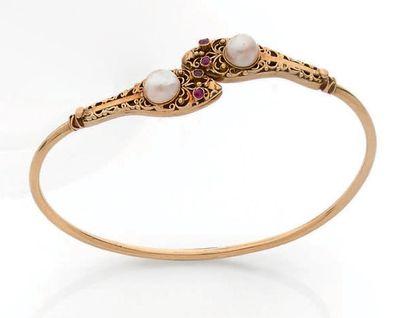Bracelet jonc ouvert en or 18K (750), les...