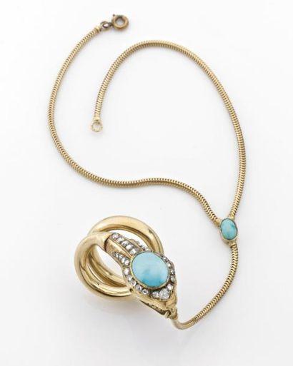 ORIGINALE BAGUE serpent formant bracelet. Monture en or rehaussée de turquoises...