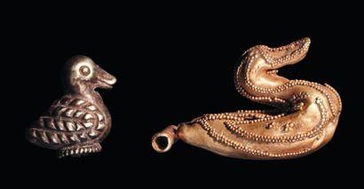 Lot composé de deux figurines représentant...