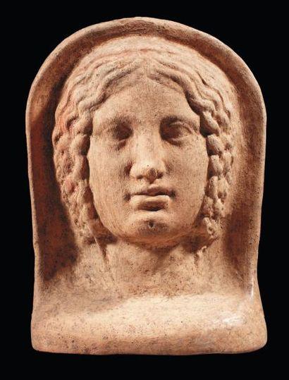 Tête votive représentant le visage d'une...