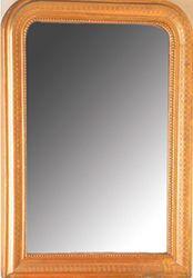 Miroir En bois stuqué et doré, les angles...