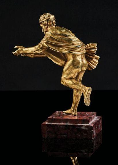 Personnage en bronze ciselé et doré représenté...
