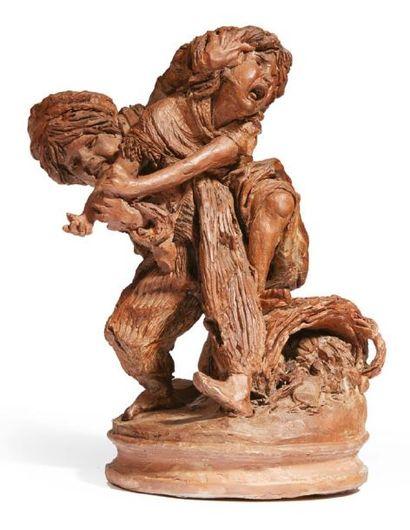 GROUPE sculpté en terre cuite représentant...