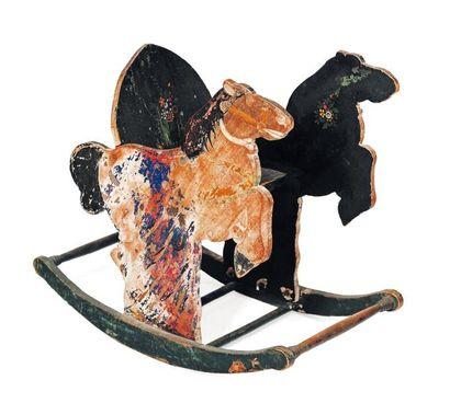 Petit cheval à bascule en bois peint polychrome....