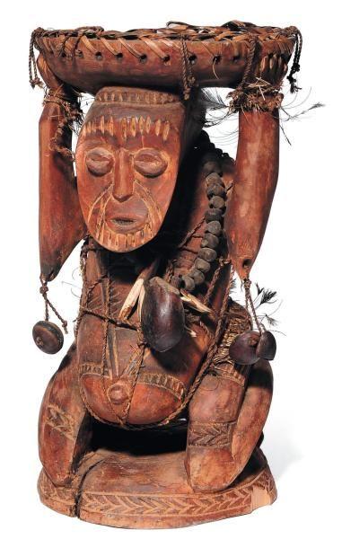 Tabouret rond africain en bois sculpté. D_20...
