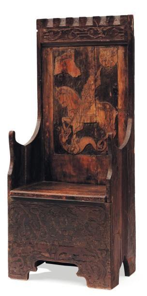 Chaise en bois sculpté à décor d'un chevalier....