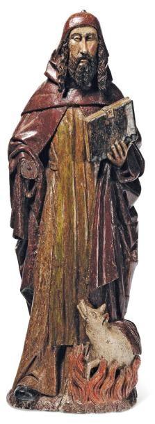Saint Antoine en chêne sculpté en rondebosse et polychromé. le saint est debout...
