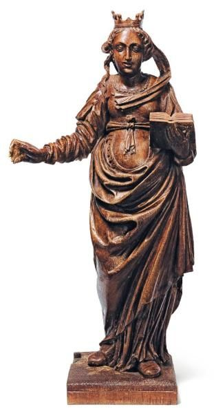 Sainte couronnée en chêne sculpté tenant...