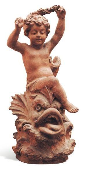 Putto sur un poisson sculpture en terre cuite....