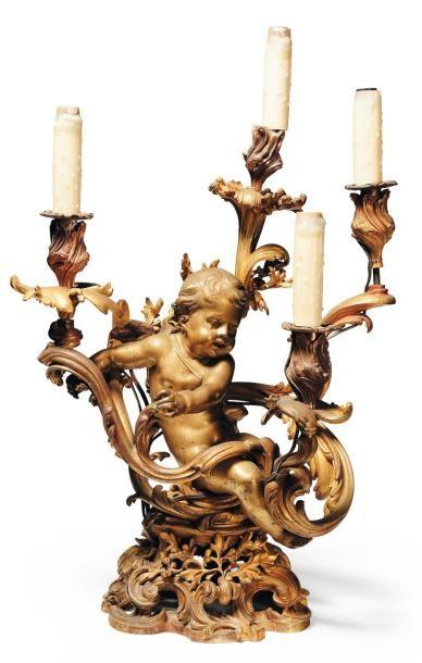 Candélabre en bronze doré à décor d'un putto,...