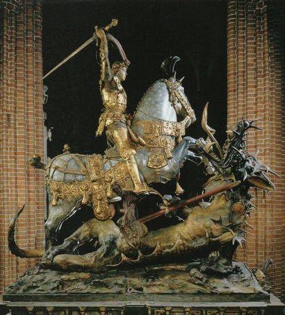 Saint Georges terrassant le dragon en bois sculpté en ronde-bosse. Monté sur un...