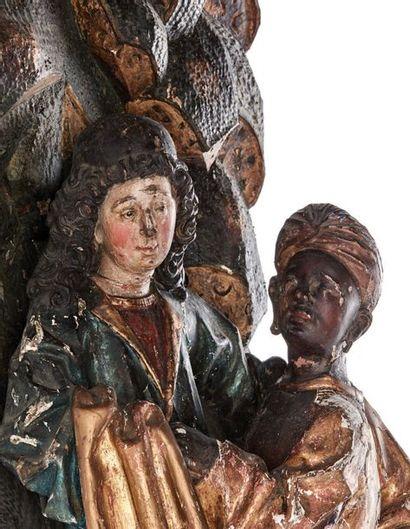 Fragment de retable en chêne sculpté en fort relief polychromé et doré représentant...