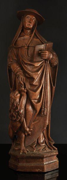 Saint Jérôme en chêne sculpté, dos ébauché. Le saint ermite est debout, tenant un...