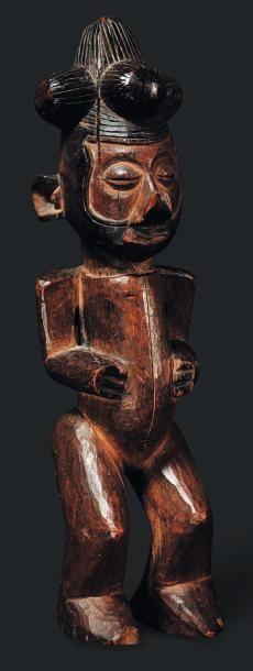 Statue Yaka, Congo - Bois. Les jambes courtes,...