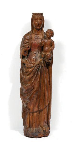 VIERGE À L'ENFANT en bois sculpté et polychromé....