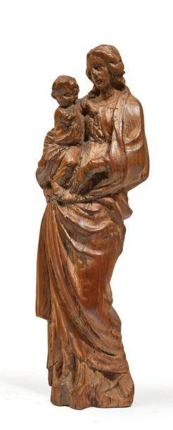 SAINT JOSEPH ET L'ENFANT JÉSUS en bois sculpté avec restes de polychromie, dos ébauché....