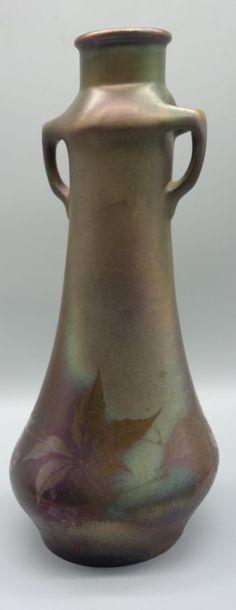 MONTIERES. Vase en céramique à corps tubulaire...