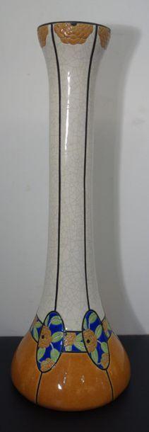 LONGWY. Vase en faïence à long col tubulaire...