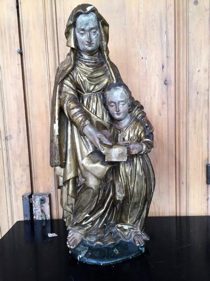Saint Anne éducatrice, bois sculpté doré....