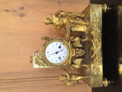 Pendule en bronze ciselé doré représentant...