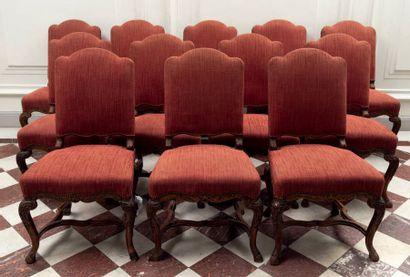 Suite de douze chaises à dossier plat en...