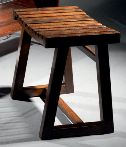 Pierre Jeanneret (1896-1967) Pair of low stools in varnished teak, with a curved...