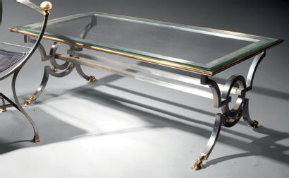 Gilbert POILLERAT (attribué à) Coffee table with rectangular white glass top encircled...