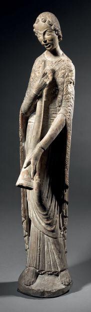 Ange musicien en pierre calcaire sculptée...