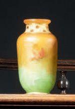 DAUM Vase miniature ovoïde épaulé sur piédouche. Épreuve en verre orange et vert....