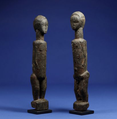 Charming couple of statuettes with simplified features. Wood with a crusty patina....