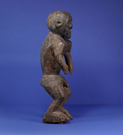 Powerful male statue representing a standing figure, legs bent and shoulders projected...