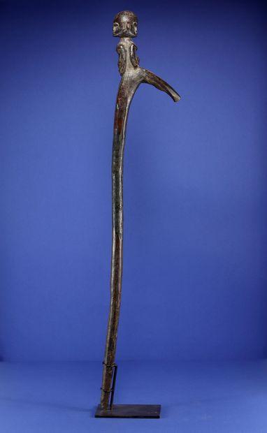 Cane with a Janus figure at the top. Wood, patina of use. Lobi, Burkina Faso. H....