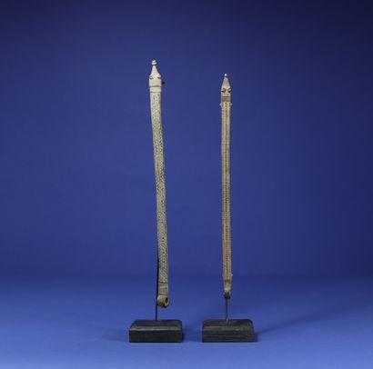 Lot of two protective bronzes in the shape of a snake. Lobi-Gan, Burkina Faso. H....