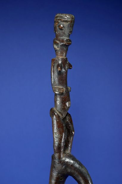 Chief's recade carved in its top with a female Janus figure. Wood with a deep patina...